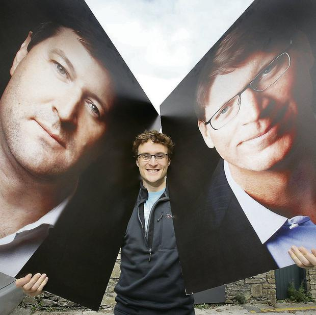 Web Summit founder Paddy Cosgrave with photos of guest speakers Liam Casey (left), founder of PCH, and Niklas Zennstrom, founder of Skype