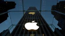 FILE - In this Wednesday, Nov. 20, 2013, file photo, the Apple logo is illuminated in the entrance to the Fifth Avenue Apple store, in New York.  (AP Photo/Mark Lennihan, File)