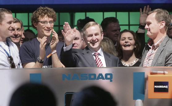 Pictured ringing the Nasdaq opening bell at the Dublin Web Summit were (from left) rugby star Jamie Heaslip, Web Summit founder Paddy Cosgrave, Taoiseach Enda Kenny and Bruce Aust, executive vice president of Nasdaq