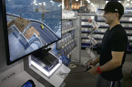 A gamer plays the new Sony PlayStation 4 in Florida. It goes on sale here next week. Joe Raedle/Getty