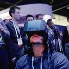 Show attendees play a video game wearing Oculus Rift virtual reality headsets at the Intel booth at the International Consumer Electronics Show(CES) (AP Photo/Jae C. Hong)