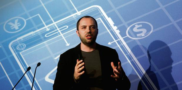 WhatsApp Chief Executive Officer and co-founder Jan Koum speaking at the Mobile World Congress in Barcelona