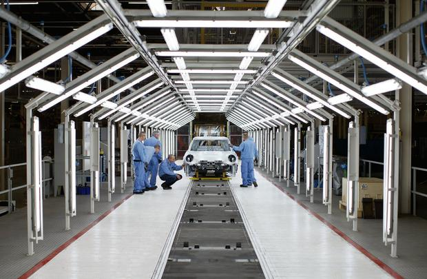 Workers inspect a MINI bodyshell at the VDL Nedcar factory, operated by the VDL Groep BV in Born, Netherlands