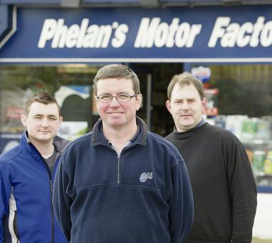 Tony Phelan, centre owner of Phelan's Motor Factors, Claremorris, Co. Mayo with his son James Phelan and Danny Pilbro