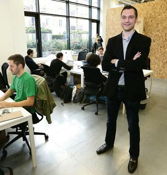 Airbnb chief technical officer Nathan Blecharczyk in their new Dublin offices - whiskey bottles and kegs adorn a themed, traditional Irish bar, but no alcohol is served