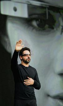 Sergey Brin, co-founder of Google, wears Google glasses while speaking at a conference in San Francisco