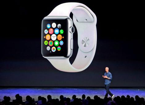 Apple CEO Tim Cook introduces the Apple Watch in September in Cupertino, California. Photo: AP