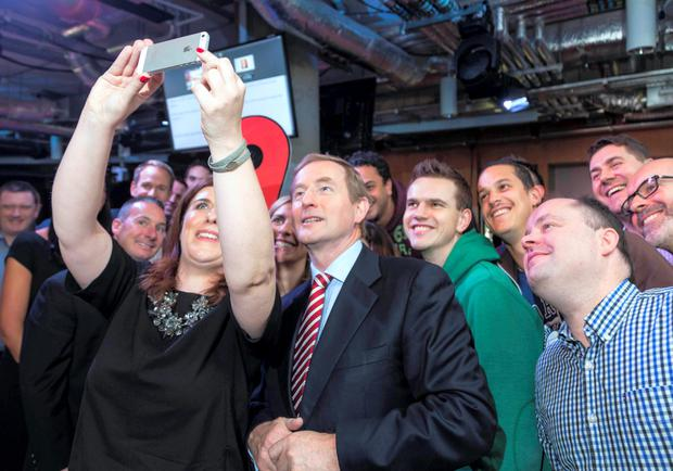 Taoiseach Enda Kenny T.D. and Sonia Flynn, Managing Director, Facebook Ireland, take a selfie with some of the Facebook staff when An Taoiseach officially open ed Facebook's new EMEA headquarters at Grand Canal Square, Dublin