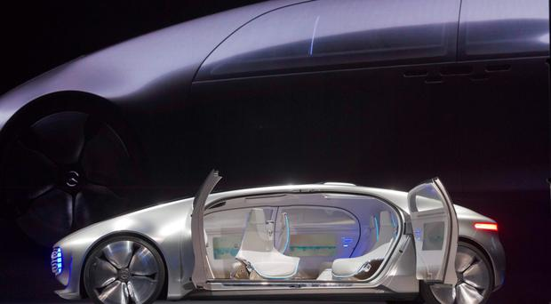 The driverless Mercedes-Benz F015 Luxury in Motion car on stage in Las Vegas.