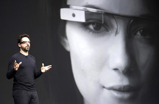 Sergey Brin, co-founder at Google Inc., wears Project Glass wearable internet glasses while speaking at a Google I/O conference