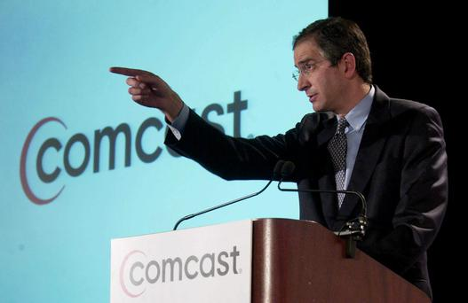 Brian Roberts, president and CEO of Comcast Corporation, speaks during a press conference in New York on February 11, 2004. Comcast Corp., the largest U.S. cable company, made a hostile bid to buy Walt Disney Co. for $54.1 billion in stock, increasing pre