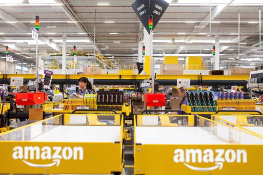 Employees process customers orders for shipping at the Amazon fulfilment centre in Bielany Wroclawskie, Poland.
