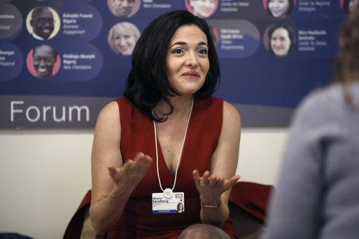 Sheryl Sandberg, billionaire and chief operating officer of Facebook Inc., left, gestures as she speaks with colleagues during a break in sessions on day two of the World Economic Forum (WEF) in Davos, Switzerland, on Thursday, Jan. 22, 2015. World leaders, influential executives, bankers and policy makers attend the 45th annual meeting of the World Economic Forum in Davos from Jan. 21-24. Photographer: Simon Dawson/Bloomberg
