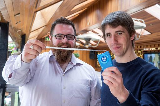 Jonny Cosgrove (left) and Bruan Henry with their new device Blue Tape, which they hope will reduce the need to send back clothes to online shop due to wrong sizes