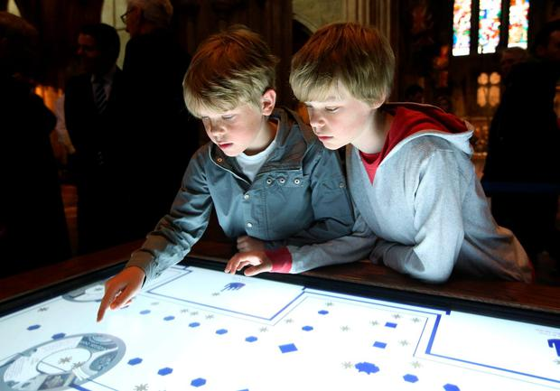 Dylan (13), right, and Oliver (9) Woods at the launch a new interactive Discovery Space Interpretative Centre at St Patrick's Cathedral yesterday
