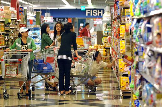 Tesco has announced the sale of its supermarket business in South Korea, knocking £4.3 billion off its total borrowings.
