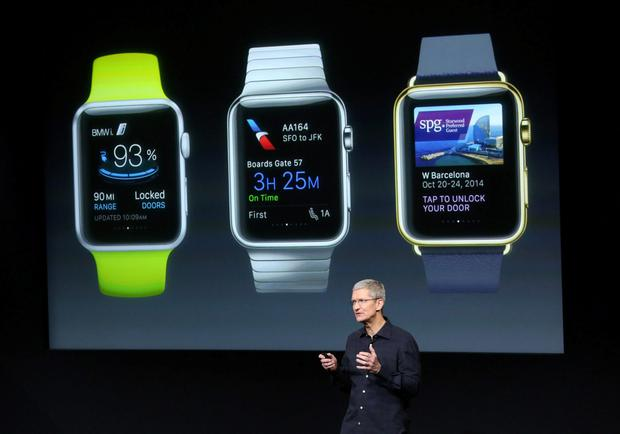Apple CEO Tim Cook stands in front of a screen displaying apps available for the Apple watch