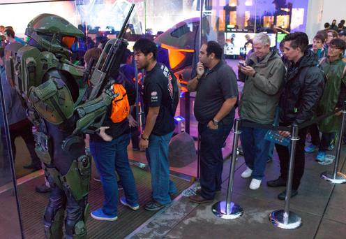 Fans celebrate the global launch of Halo 5: Guardians at the Microsoft store in Seattle last Monday