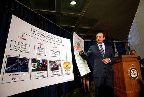 Preet Bharara, U.S. Attorney for the Southern District of New York, speaks next to a chart explaining the scheme during a news conference in New York.