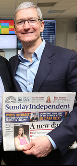 Apple chief executive officer Tim Cook, who last week paid a visit to Independent News and Media's offices on Talbot Street, Dublin, with his copy of the Sunday Independent