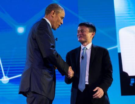 US President Barack Obama and the chairman of e-commerce giant Alibaba, Jack Ma (R), shake hands as they take part in the Asia-Pacific Economic Cooperation (APEC) CEO summit in Manila. Photo: AFP/Getty Images