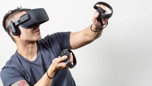 Using an oculus touch, with the hand controllers to 'recognise natural hand poses like pointing, waving, or giving a thumbs-up'