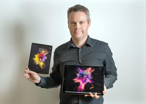 Ronan Price with the new iPad Pro and smaller iPad Air for comparison