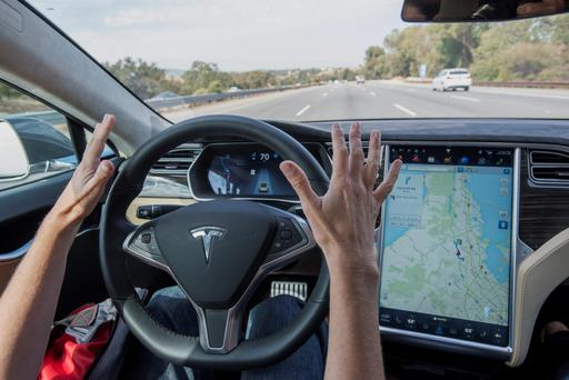 The scramble is on to corner the driverless cars future. Pictured is an autopilot model already being produced by Tesla