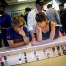 Customers look at the Apple Watch at the Apple Store in June 2015 on Fifth Avenue in New York City