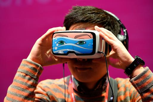 A boy tests the 'Oculus VR' virtual device, at the Mobile World Congress in Barcelona
