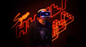 Game developer Marc Flury plays Kokoromi's Superhypercube on Sony's PlayStation VR during an event in San Francisco, California.