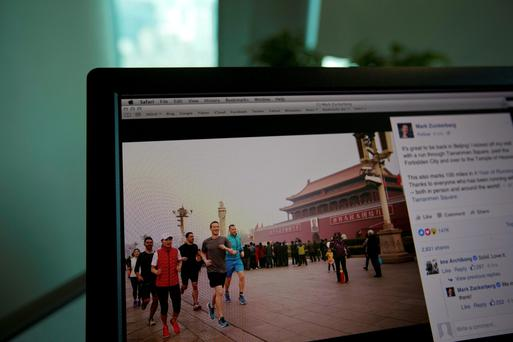 A computer screen showing Mark Zuckerberg's 'smog jog' through Tiananmen Square in the Chinese capital