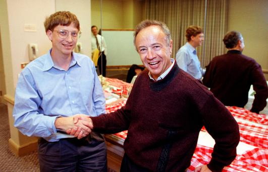 Intel chief executive Andy Grove shakes hands with Microsoft chairman Bill Gates in 1992.