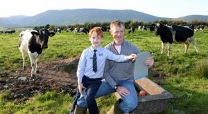 Kerry dairy farmer Patrick Rohan with his son Liam on his farm outside Annascaul. Photo: Don MacMonagle.