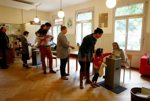 Voters cast their ballots in the recent Swiss referendum.