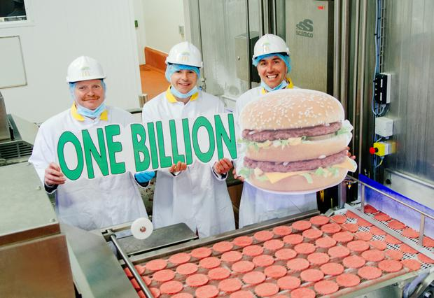 Richard Clinton of Dawn Meats, Nigel Maguire of McDonald's Ireland, and Peter Roche of Dawn Meats mark the billionth burger produced at at Carroll's Cross
