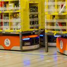 Kiva Systems LLC robots move shelves to fill orders at the Amazon.com fulfillment centre in Tracy, California. Photo: Bloomberg
