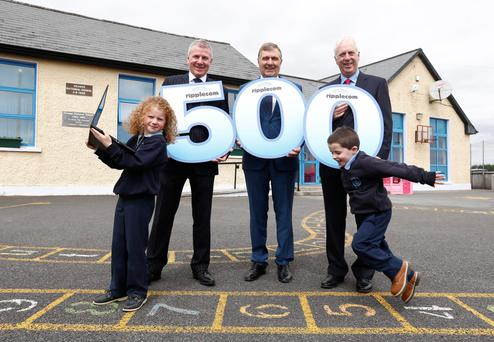 Grange Primary School, Roscommon, pupils Shaunagh McGrath (8) and Oisin Nangle (5) with Ripplecom, representives John Regan, head of sales, John McDonnell, managing director, and John Sheridan, chairman, as the school got broadband. Photo: Conor McCabe Photography.
