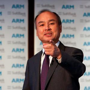 Billionaire Masayoshi Son, chairman and chief executive officer of SoftBank Group, gestures whilst speaking during a news conference in London