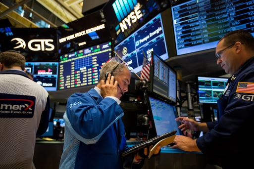 Traders on the floor of the New York Stock Exchange, which is due for a massive shake-up in its data operations