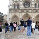 Tourists at Notre Dame in Paris