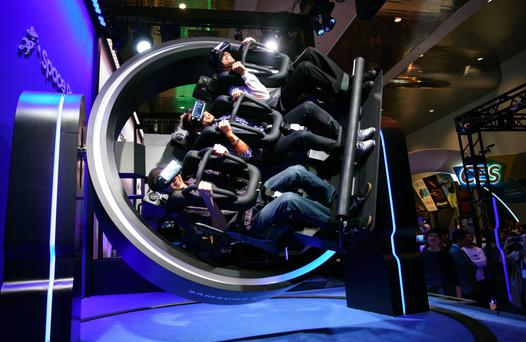 Attendees ride the Samsung Galaxy Gear VR 4D Experience during the 2017 Consumer Electronics Show (CES) in Las Vega