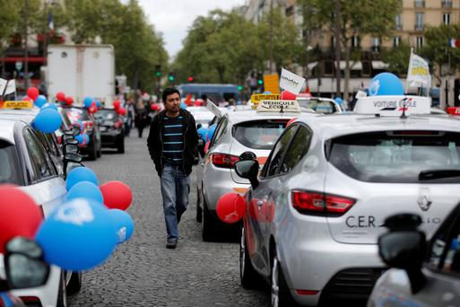 French driving instructors brought Paris to a standstill as they joined protests against Uber. REUTERS/Benoit Tessier