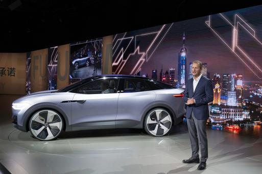Herbert Diess, chairman of the board of management of the Volkswagen brand, presents the I.D. CROZZ in Shanghai. VW says it aims to produce new electric models which match current prices and are set to be more affordable than the Tesla 3