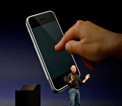 Former Apple CEO Steve Jobs announcing the technology brand's first iPhone in San Francisco