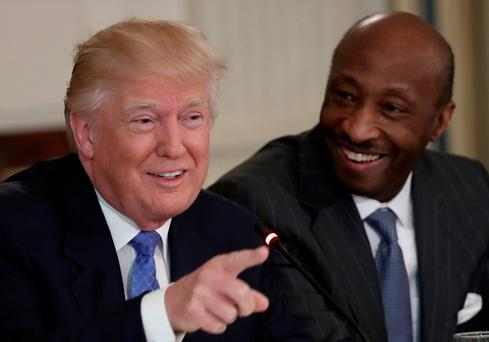 Donald Trump with Merck CEO Kevin Frazier, who stepped down from a White House advisory group after the death of a counter protestor at a far-right rally in Charlottesville