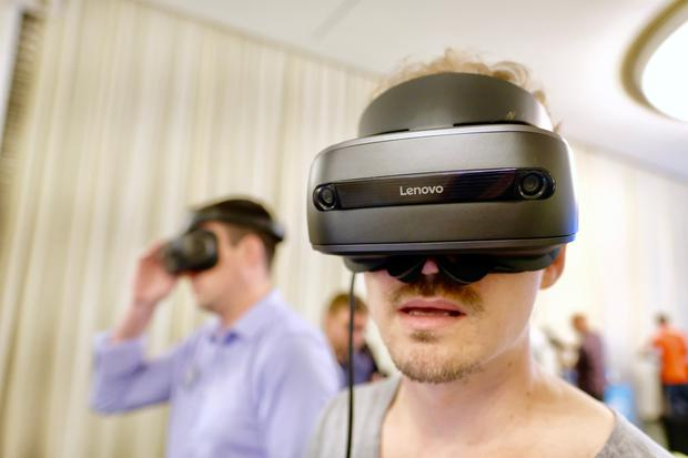 A visitor tries out the Lenovo Explorer mixed reality' headset at the IFA consumer electronics show in Berlin. Photo: Adrian Weckler