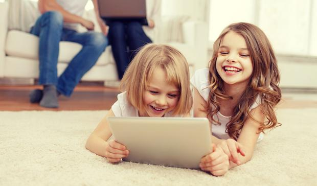 Kids watching movies on a tablet