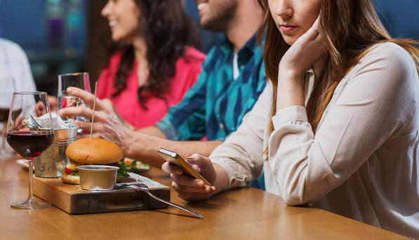 If someone ignores you in favour of their phone, that's not addiction – that's plain bad manners. Stock image
