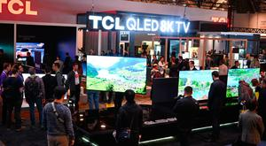 Attendees look at 8K televisions at the TCL booth at CES 2019 consumer electronics show, January 10, 2019 at the Las Vegas Convention Center in Las Vegas, Nevada